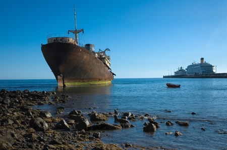 Wreck and modern ships in Arrecife, Lanzarote, Canary Islands Stock Photo - 12835861