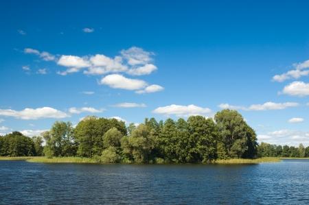 masuria: Small islands on the lake in Masuria district, Poland
