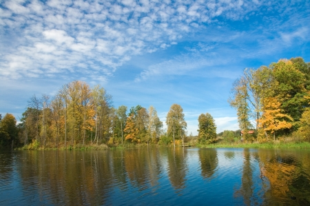 View of river bank with colorful autumn trees photo