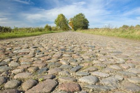 masuria: Old cobblestone road through the fields, Masuria, Poland