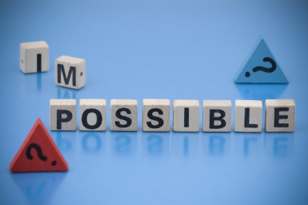 Question  IMPOSSIBLE or POSSIBLE  made of letters on the wooden blocks photo