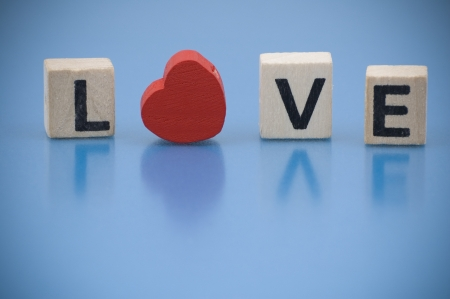 Word LOVE made of letters on wooden blocks photo