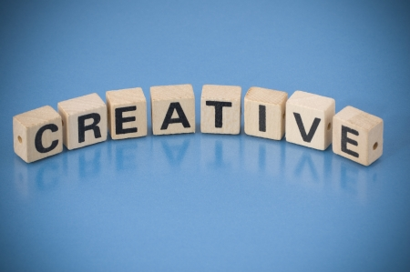 The word CREATIVE made of letters on wooden blocks photo