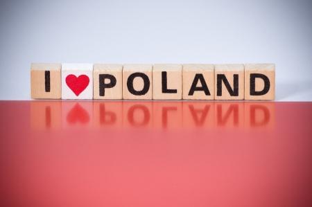Text I LOVE POLAND on Polish flag colors background photo