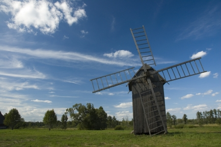 Old wooden windmill in the countryside photo
