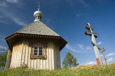 Old, wooden orthodox chapel in Bialowieza, Poland photo