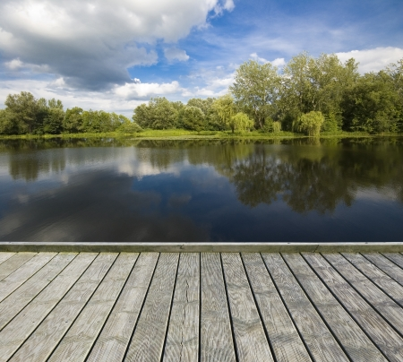 Empty wooden jetty on the lake shore Stock Photo