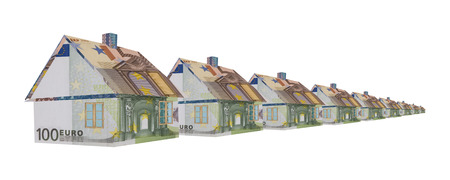 Row of houses made of Euro banknotes isolated on white  photo