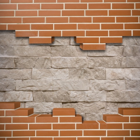 Broken red brickwall with stonewall in the background Stock Photo - 24155534