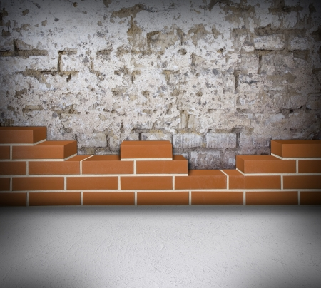 Room with partially built red brick wall and damaged white wall Stock Photo - 24461796