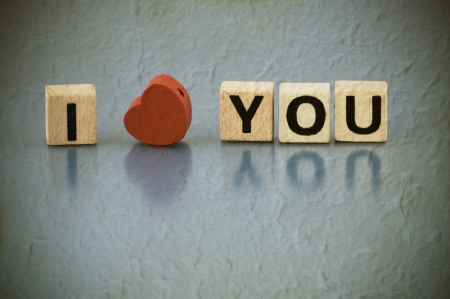 Text I LOVE YOU made of letters on wooden blocks photo