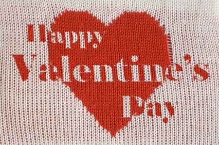 Knitted red heart shape and inscription  Happy Valentines Day  on white background photo