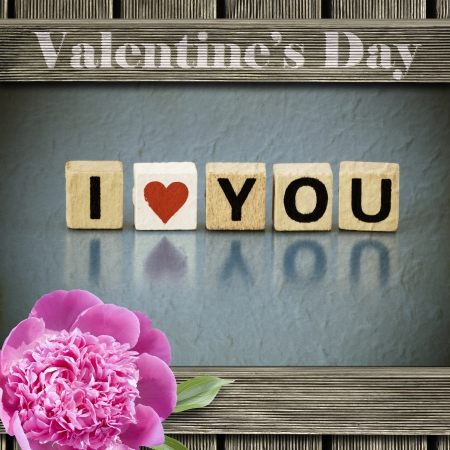 Valentines Day background - vintage frame with text I LOVE YOU made of letters on wooden blocks photo