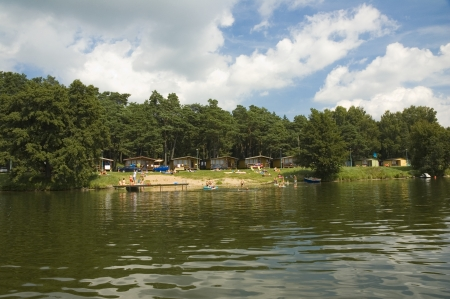 Camp site on the lake shore in Masuria district, Poland Stock Photo - 25228889