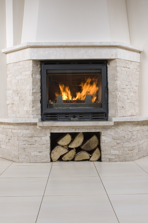 stone fireplace: Interior design of living room with fireplace