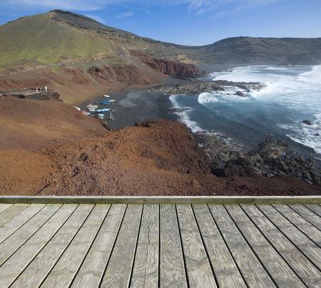 golfo: Empty wooden terrace with view of coastline of Atlantic ocean Stock Photo