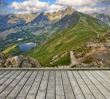 Empty wooden terrace with mountain landscape in the background photo