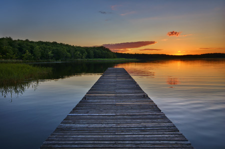 View of beautiful calm lake just after sunset, Mazury, Poland Stock Photo