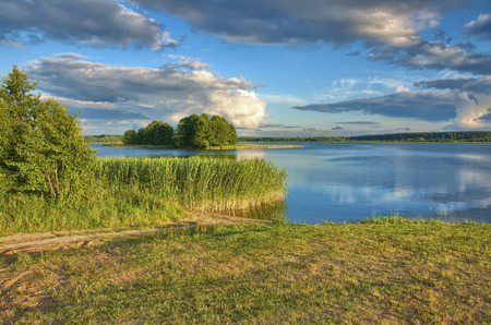 View of lake shore and small island on the lake, Mazury, Poland photo