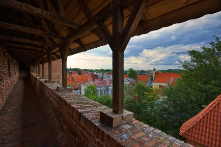 sentry: Defensive walls and sentry porch of medieval Gothic castle in Reszel, Poland