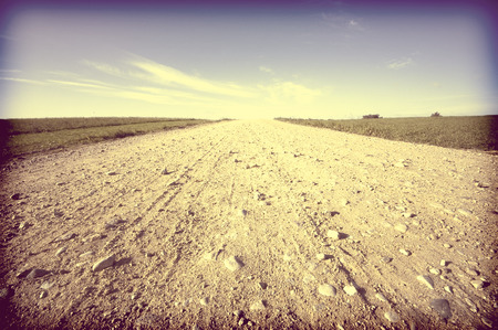 bumpy: Vintage view of country road running through field