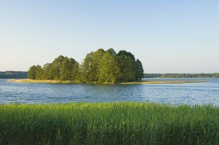 masuria: View of small island on the lake in Masuria district at the break of dawn, Poland Stock Photo