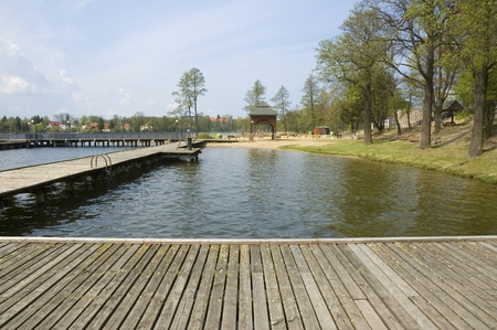 lake: Wooden footbridge on natural baths on a lake, Mazury, Poland Stock Photo