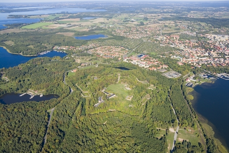strategically: Aerial view of strategically located Boyen stronghold in autumn time, Gizycko town in the background, Poland
