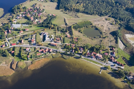 masuria: Aerial view of Ogonki - tourist resort in Masuria District located between Swiecajty and Stregiel Lakes, Poland Stock Photo