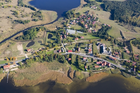 masuria: Aerial view of Ogonki - tourist resort in Masuria District located between Swiecajty and Stregiel Lakes, Sapina River on the left, Poland
