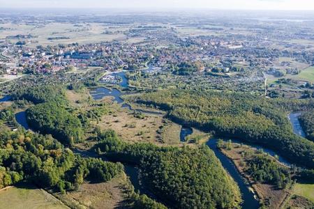 meanders: Aerial view of meanders of Wegorapa River, Wegorzewo town in the background, Mazury, Poland