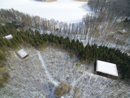 Aerial view of the reinforced concrete bunkers belonged to the Headquarters of the Nazi Land Forces (Oberkommando des Heeres) from ww2 hidden in the forest in Mamerki, Poland (formerly Mauerwald, East Prussia)