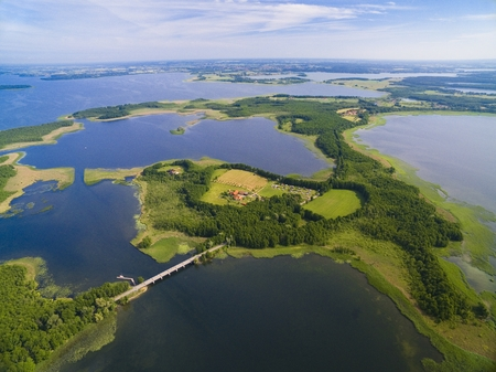 Aerial view of beautiful landscape of lake district, bridge between Dargin and Kirsajty Lakes, next Mamry Lake, Mazury, Poland