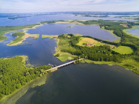 Aerial view of beautiful landscape of lake district, bridge between Dargin and Kirsajty Lakes, next Mamry Lake, Mazury, Poland
