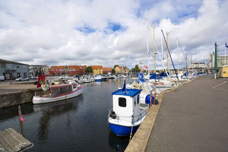 NEXO, DENMARK - AUGUST 20, 2018: View of fishing boats and yachts moored in the harbor Redakční