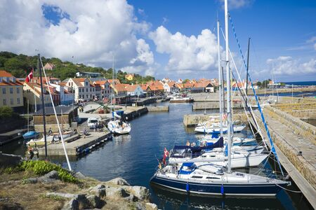 GUDHJEM, DENMARK - AUGUST 21, 2018: View of fishing boats and yachts moored in the harbor Redakční