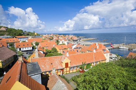 Aerial view of small town - with beautiful, small houses - at the seaside, Gudhjem, Bornholm, Denmark