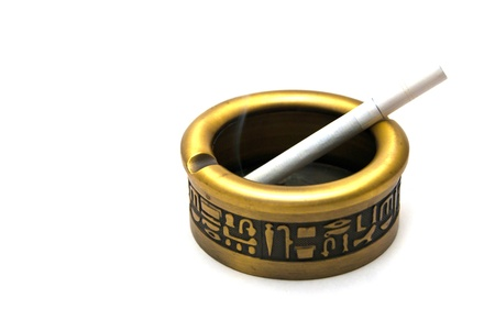 Egyptian ashtray with cigarette