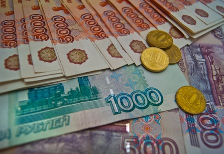 Russian banknotes and  ten rubles coins background photo