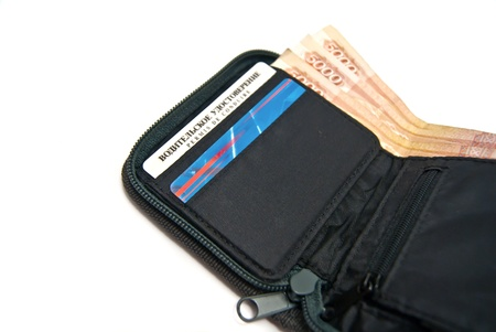Big money and credit cards in wallet. On white background photo