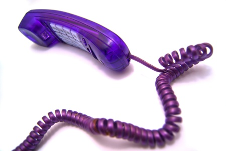 Purple handset with a wire on white Stock Photo