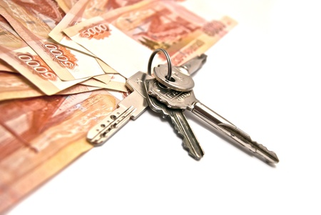 Russian banknotes and house keys on white photo