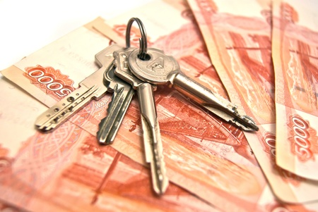 Keys and Russian banknotes background