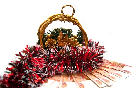 Money gift under Cristmas basket on white photo
