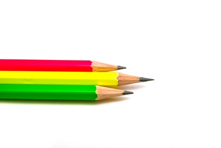 three pencils close-up on white background
