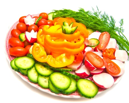 different vegetables on a plate on white background Stock Photo