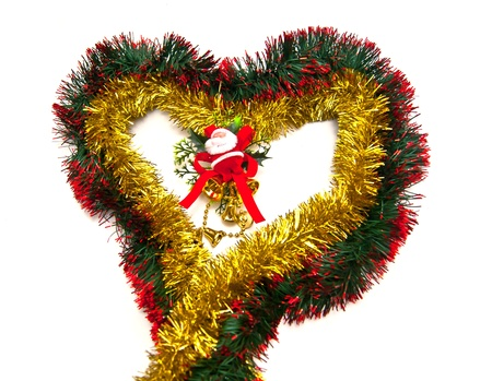 Tinsel heart and Santa figurine on white