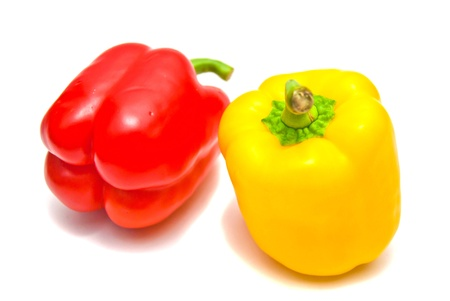 Red and yellow peppers on white background