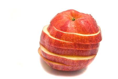 red apple slices on white background