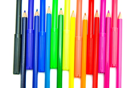 pencils and markers on white background photo